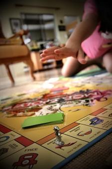 monopoly-reaching.jpg
